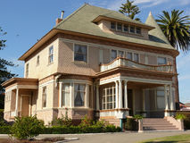 Old Mansion. With palm trees and grand entrance and balcony on top Stock Photo