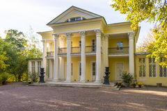 The old mansion with columns in the autumn park Stock Photo