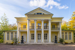 The old mansion with columns in the autumn park Stock Images
