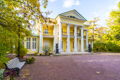 The old mansion with columns in the autumn park Royalty Free Stock Image