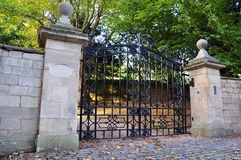 Old Mansion Gates. Mansion gates and wall in Palladian architectural style stock photo