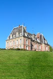 Old mansion on green hill. View on beautiful landscape with old mansion at Saint Saens, France stock photo