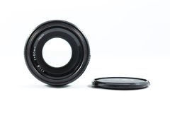An old manual control camera lens isolated on white. Royalty Free Stock Photography