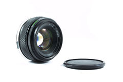 An old manual control camera lens isolated on white. Royalty Free Stock Photos
