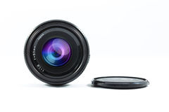 An old manual control camera lens isolated on white. Royalty Free Stock Images