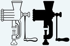 The old manual meat grinder. Image isolated on blue background Royalty Free Stock Photo