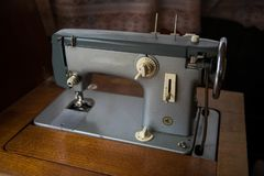 Old manual sewing machine on the photo royalty free stock images