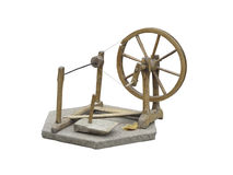Old manual wooden spinning-wheel distaff isolated on white Royalty Free Stock Photo