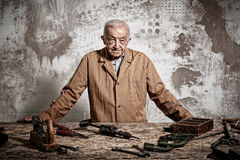 Old manual worker Stock Images