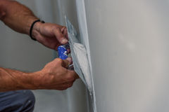 Free Old Manual Worker With Wall Plastering Tools Renovating House Stock Photos - 97929473