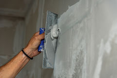 Free Old Manual Worker With Wall Plastering Tools Renovating House Royalty Free Stock Image - 97929516