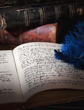Old manuscript. Feather, old books and manuscript on the table Stock Images