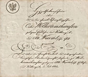 Old manuscript with calligraphic handwritten text. Grunge vintage paper background stock images