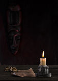 Old manuscript and candle. Reading old manuscripts by candlelight Royalty Free Stock Photos