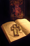 Old manuscript with cross. Old manuscript and icon,with my silver cross.This icon is my drawing product Royalty Free Stock Image