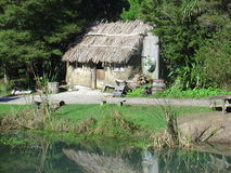 Old Maori Hut. A photo of an old Maori hut beside a small lake found on the North Island of New Zealand Royalty Free Stock Image