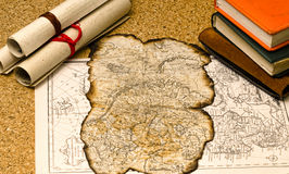 Old map with burnt edges. Lies on the surface of the cork Royalty Free Stock Images
