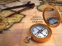 Old map and compass. Old drawing compass, orientation compass, and an old map. 3d render. The map is my own model Royalty Free Stock Photos