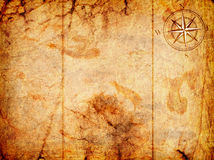 Old map with a compass. On it on a grunge background Stock Photos