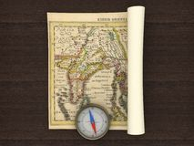 Old Map and Compass. On the table Royalty Free Stock Photo