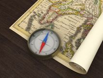 Old Map and Compass. On the table Stock Photography