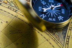 Old map with compass. Map is a drawing or plan of the surface of the earth that shows countries, mountains, roads, etc Royalty Free Stock Photography