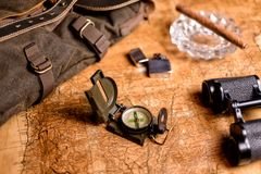 Old map with compass and binoculars Stock Image