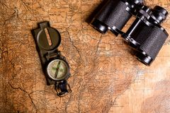Old map with compass and binoculars Stock Photography