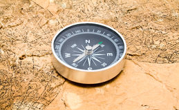 Old map and compass on a white background Royalty Free Stock Image