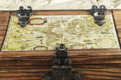 Old map embedded in the top of a wooden box Royalty Free Stock Photo