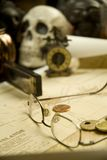 Old map with glasses and skull Royalty Free Stock Images