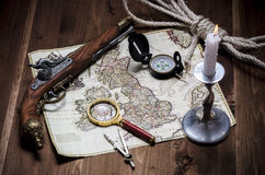 Old map with gun. Old map with the deification on a wooden table Royalty Free Stock Photo