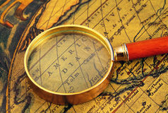 Old map and  magnifier Royalty Free Stock Images