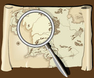 Old map with magnifier Royalty Free Stock Images