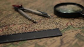 Old map with magnifier, divider and ruler. 1 stock footage