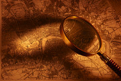 Old map and magnifying glass Stock Photo