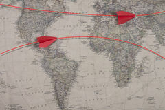 The old map and red color paper airplane Royalty Free Stock Images