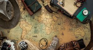 Old map, vintage travel equipment and souvenirs from the travel around the world. Old map, retro travel equipment and souvenirs from the travel around the world royalty free stock images