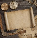 Old map scroll with compass. Adventure and travel background concept. 3d illustration. Old map background with compass. Adventure or discovery concept Royalty Free Stock Images