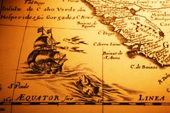Old Map Sea Monster Sailing Ship Equator Africa. Detail from an old map showing a ship about to cross the equator, a sea monster and the coast of Africa. Map is royalty free stock photography