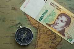 Old map of south america with argentine money and compass, close-up stock photos