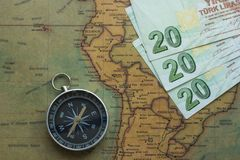 Old map of south america with money and a compass, close-up stock photos