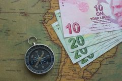 Old map of south america with money and a compass, close-up stock photo
