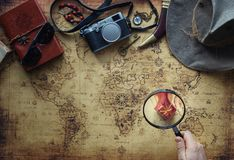 Old map and vintage travel equipment / expedition concept, treasure hunt. Or holiday gifts royalty free stock photography