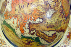 Old map of the world on the globe. Part of the old map of the world on the globe Royalty Free Stock Photography