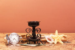 Old map world, parchment, watches, money, candlestick on red-orandevy. Stock Photography