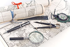 Old Maps with compass and magnifier royalty free stock photo
