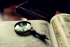 Old maps and a magnifier Stock Photography