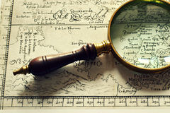 Old maps and a magnifier Royalty Free Stock Images