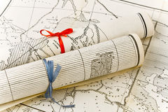 Old Maps in rolls with colorful ribbons Royalty Free Stock Image